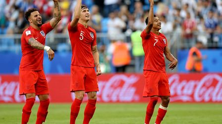 England's Kyle Walker (left), John Stones (centre) and Jesse Lingard (right) celebrate after the fin