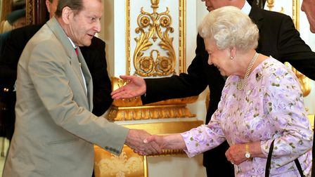 Lucian Freud meets the Queen in 2009 Picture: JOHN STILLWELL/PA WIRE