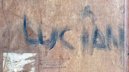 Experts agree the signature on the back of the canvas is Freud's Picture: SWORDERS