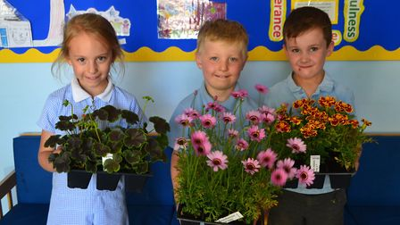 Pupils at Chelmondiston primary school with some of the plants donated to the school by Ipswich-base