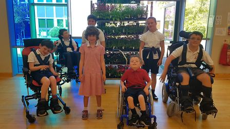 Pupils at Thomas Wolsey School in Ipswich with some of the plants donated by Ipswich-based Thompson
