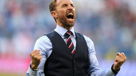 Gareth Southgate roars right as he celebrates victory after theWorld Cup Quarter Final match at the