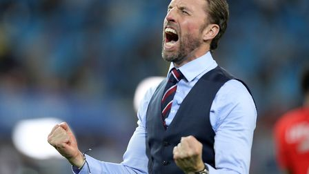 England manager Gareth Southgate roars left as he celebrates Englan's victory over Colombia Photo: P