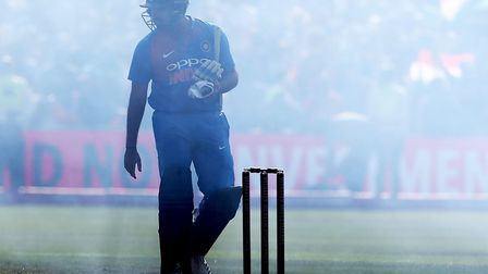 India's Rohit Sharma looks through the firework smoke during the t20 clash at the Brightside Ground,