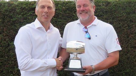 Mark Lewis (right) receives the Silver Barrel from Ipswich club captain Chris Mayhew. Photograph: TO