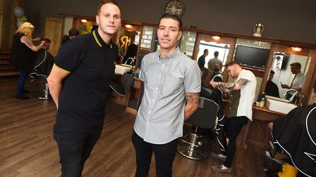 Ambrose (right) and business partner Nathan Head at their barbers shop in Duke Street. They also ha