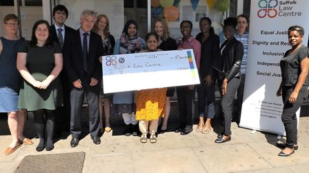 Photo caption: Peter Blake (4th from left) from Prettys presented a cheque to Suffolk Law Centre
