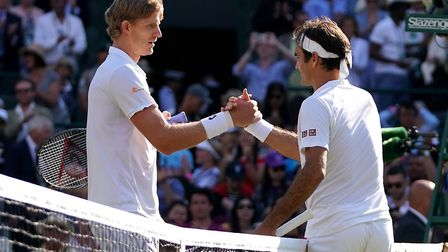 Kevin Anderson (left) shakes hands with Roger Federer after his win in the quarter finals Photo: PA