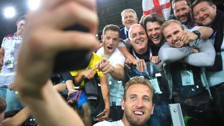 England's Harry Kane takes a selfie with fans after his side win the penalty shoot out of the FIFA W