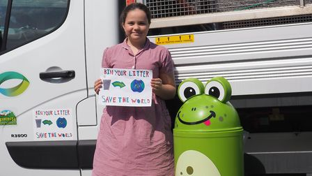 Maddie Scott with her winning design and the froggy bin which was donated to the school Picture: BAB