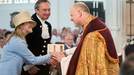 Joe Hawes, centre, who was installed as Dean of St Edmundsbury, receives a warm welcome from members