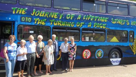 Members of Sudbury Rotary Club outside the learning bus at Pot Kiln Primary School with headteacher