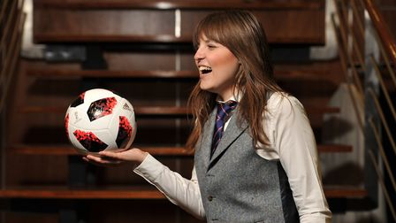 Amy Gibbons tries on a few waistcoats at Coes for Waistcoat Wednesday Picture: SARAH LUCY BROWN