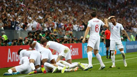 England's Kieran Trippier celebrates scoring his side's first goal of the game with team mates. Pict