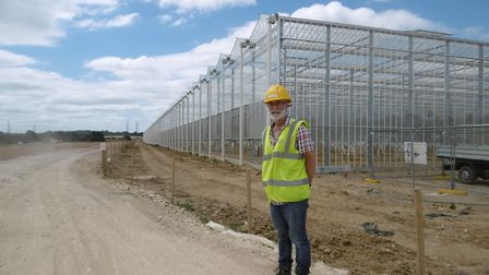 Cliff Matthews, a director of Sterling Suffolk Ltd., inside the giant glasshouse being built on land