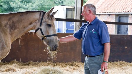 Jacko Jackson with a new arrival at World Horse Welfare. Picture: World Horse Welfare