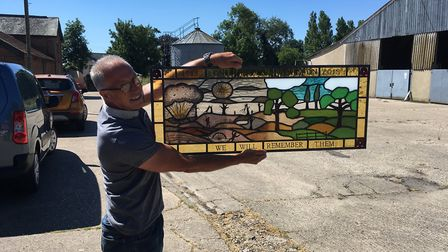 Jon Messum with his stain glass window for the World War 1 Trail in Bury St Edmunds. Picture: RUSSEL