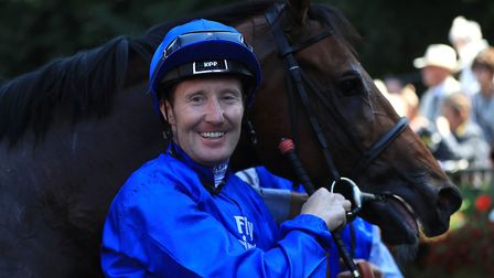 Pat Cosgrave poses with Best Solution after winning at Newmarket. Picture: PA SPORT