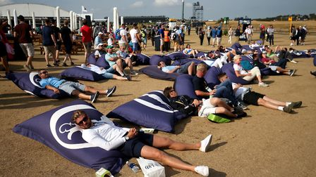Spectators lay on giant bean bags watching the action on the big screen at the Open. Look at the par