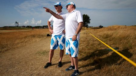Spectators watch the action at sun-drenched Carnoustie Photo: PA