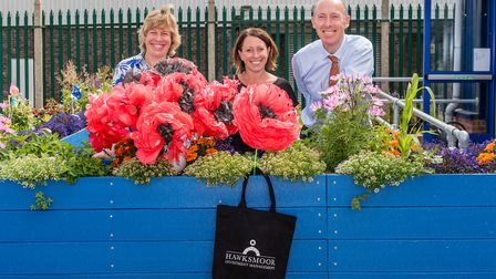 Pictured with the poppies are left to right are Melanie Lesser, Bury in Bloom co-ordinator, with Mic