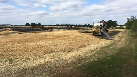 Fire crews tackling a previous crop fire in Suffolk Picture: RUSSELL COOK