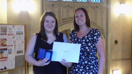 Courtney Prior of Headway Suffolk receiving her award from Sam Willis of award sponsor Clarke Care L