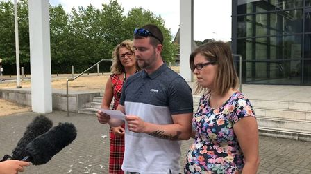 Stevie Searle with his wife Victoria speaking outside Ipswich Crown Court after his father, Stephen,