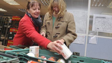 Maureen Reynel MBE and volunteer Alex Townsend work on sorting donations at FIND Foodbank in Ipswich
