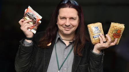 Colchester Foodbank manager Michael Beckett, pictured wiht out of date food the organisation receive