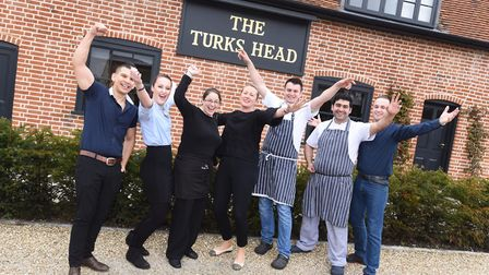 Staff from The Turks Head, in Hasketon, arehoping for more awards Picture: GREGG BROWN