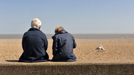 People enjoy their fish and chips on Aldeburgh beach. Picture: SARAH LUCY BROWN