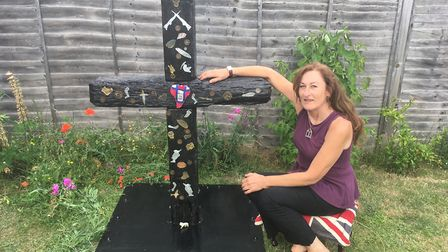 Marie Roby and her trench art cross.