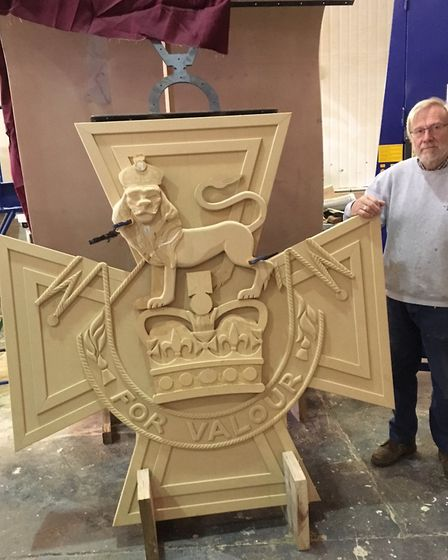 Mike Wells with his wooden Victoria Cross.