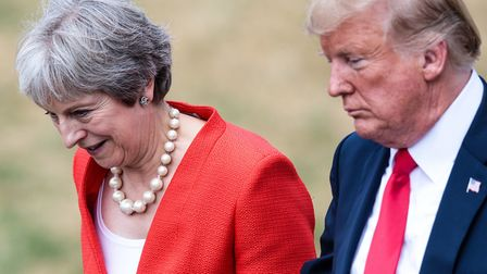 US President Donald Trump with Prime Minister Theresa May as they arrive for a joint press conferenc