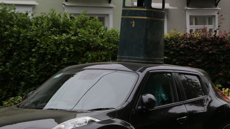 A bin was also left on a car near to the destroyed bus shelter in Wickham Market Picture: JULIAN EVA