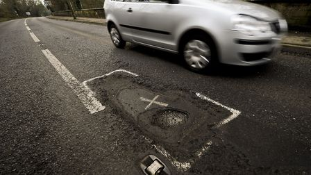 X marks the spot - another pothole waiting repair Picture: PA