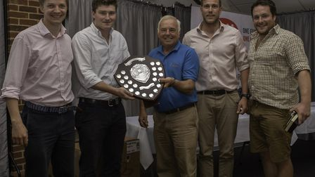 The winning team from Padleys being presented with the trophy by John Bidwel, centre. The team membe