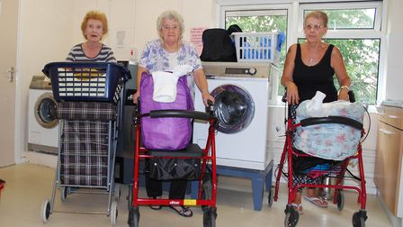 Pat Zapien, left, Iris Simpson, centre, and Shirley O'Neill, in the laundry at Barlings Court, in Ne