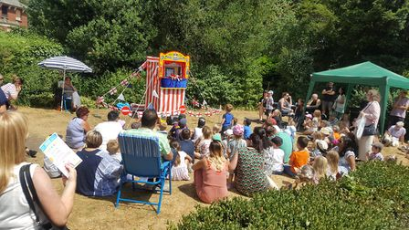 People enjoying the Punch and Judy show at Party in the Park, in Sudbury. Picture: AMI BIRRELL