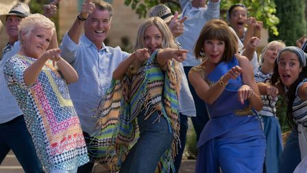 A scene from Mamma Mia! Here We Go Again. From left, Julie Walters as Rosie Mulligan, Pierce Brosnan
