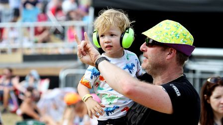 A dad introduces his young son to some rather loud rock music on stage Picture: JAMES AGER
