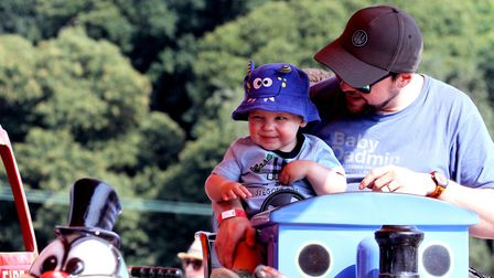 Jack Lovell enjoys his first ever ride with his dad Chris looking after him Picture: JAMES AGER