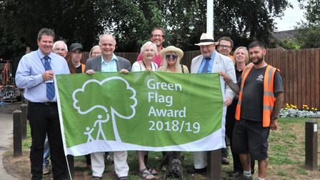 Chase the dog joins parks staff, councilors and Friends to mark the awarding of the park's 11th Gree