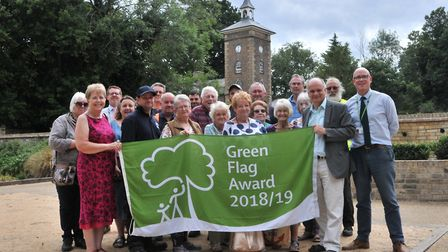 Visitors, Friends, councilors and staff assemble in the Walled Garden after being awarded Holywells'