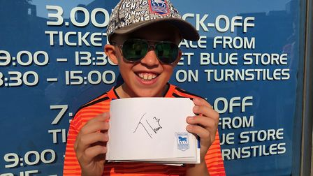 Blues fan Kiaran Overton, 9 1/2 years old, shows off his signature collection ahead of Ipswich Town'
