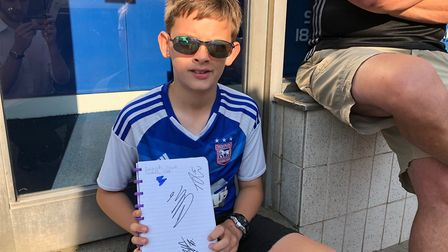 Jack Hatherall and last year's Open Day autograph page. He's been at the stadium since 8.15am waitin