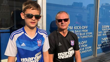 Tom and Jack Hatherall Waiting for a chance to see some Ipswich players og a signature and a photogr