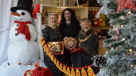 Jane Bolton (left) and mayor Jan Garfield present the Bolton Challenge Trophy to the Thrifty Thistle