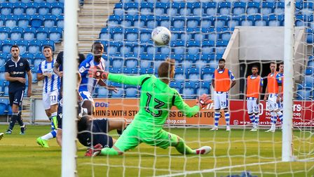 Kane Vincent-Young beats Millwall keeper Ben Amos to put the U's 2-0 ahead. Picture: STEVE WALLER